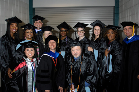 2018 UHV Fall Commencement Ceremony graduates posing for a photo