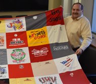 Retired UHV administrator uses 40 years of T-shirts to create quilt