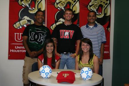 Five Victoria-area soccer players sign on Wednesday to play in the fall with the first University of Houston-Victoria Jaguars soccer teams. Seated, from left, are Stacie Garcia and Courtney Day, and standing, from left, are Mark Rojas, Seth Prochaska and Stiven Ospina.