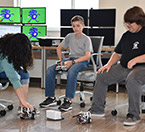 High school students direct robots at UHV summer camp