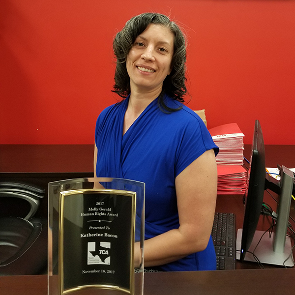 Katherine Bacon displays her Molly Gerald Human Rights Award