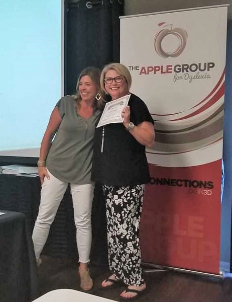 Carol Klages, right, a University of Houston-Victoria associate professor of Education and a dyslexia specialist, receives her certified dyslexia therapist license