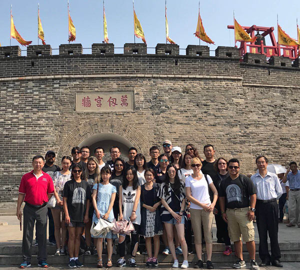 Students and faculty from UHV and two Chinese universities stand at the entrance to Chinese teacher and philosopher Confucius' hometown