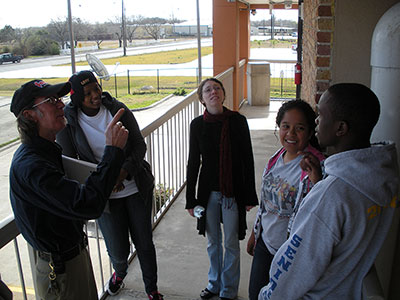 Gerald Kelley, Jaguar Hall maintenance supervisor, points out safety features to Resident Advisers Lauren Clark, left, Anita Strange, Ashley Kellis-Carr and Moses Olukoya.